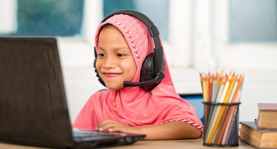 Muslim girls studying online at home To reduce social distance and prevent communicable diseases
